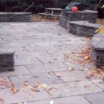 Flagstone patio with retaining wallstone