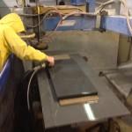 Stone finishing process on a bluestone bench