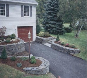 Curved wallstone planters surrounding a driveway